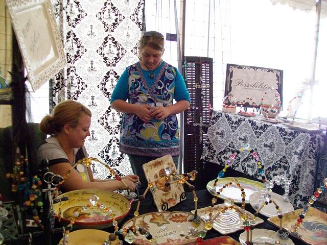 Vendors at  War Eagle Craft Fair talk about their craft.