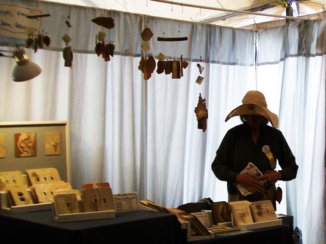 Vendors explain their work at War Eagle Craft Fair.
